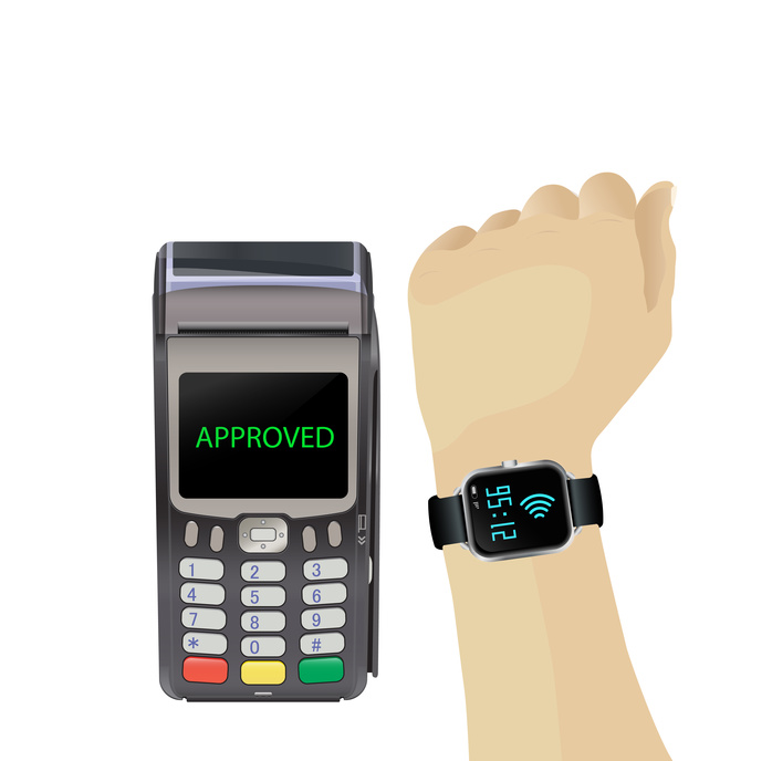 POS terminal with hand and smartwatch. Payment approved by smartwatch.